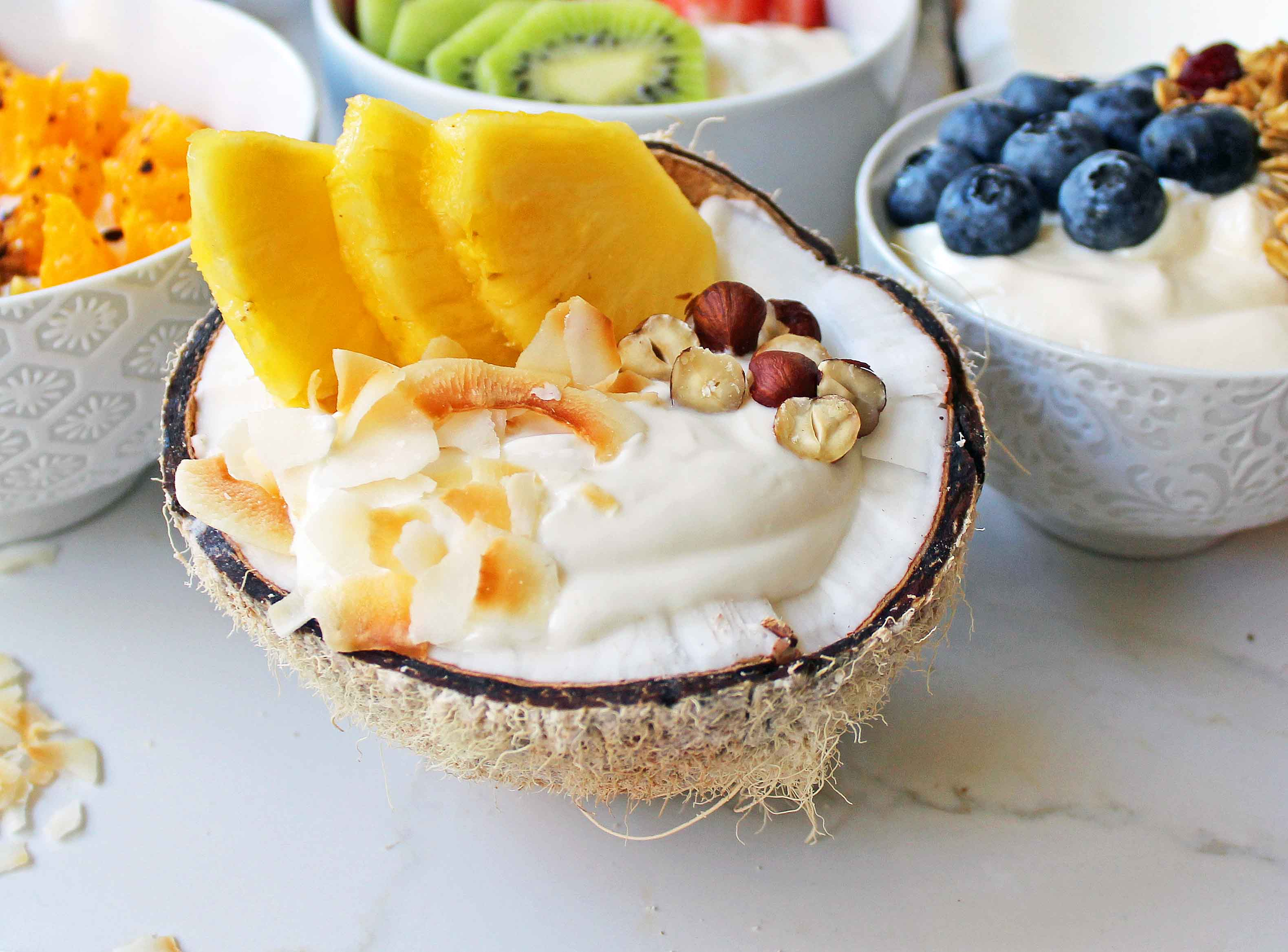 Greek Yogurt Breakfast Bowls with Toppings by Modern Honey. Healthy Greek Yogurt topped with fresh fruits, nuts, and honey. It's a perfect breakfast to start the day!
