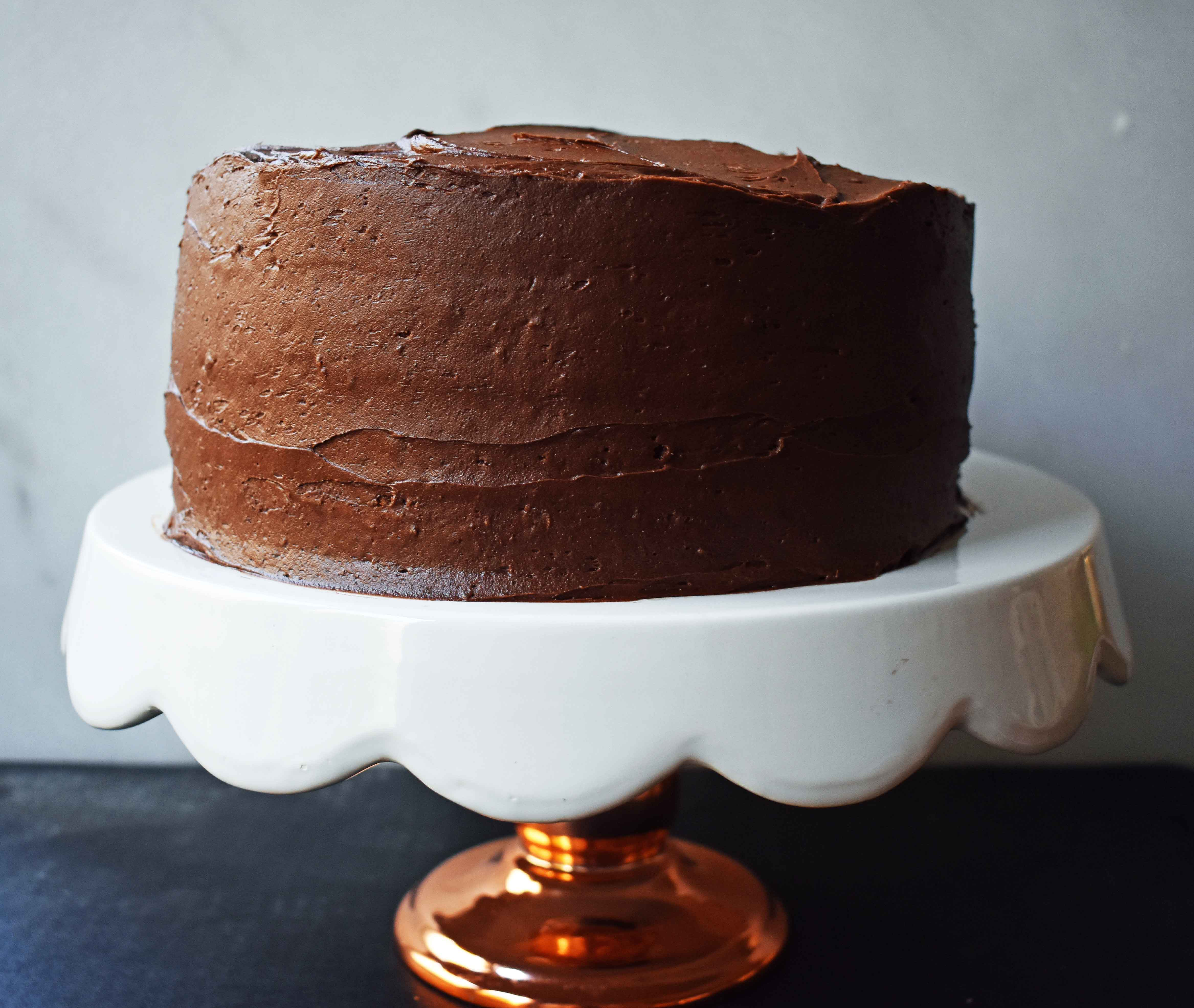 Yellow Birthday Cake with Milk Chocolate Frosting by Modern Honey. Homemade Yellow Cake with Vanilla Pudding Mix to make it extra moist and flavorful. Rich chocolate buttercream is the perfect addition to this birthday cake.