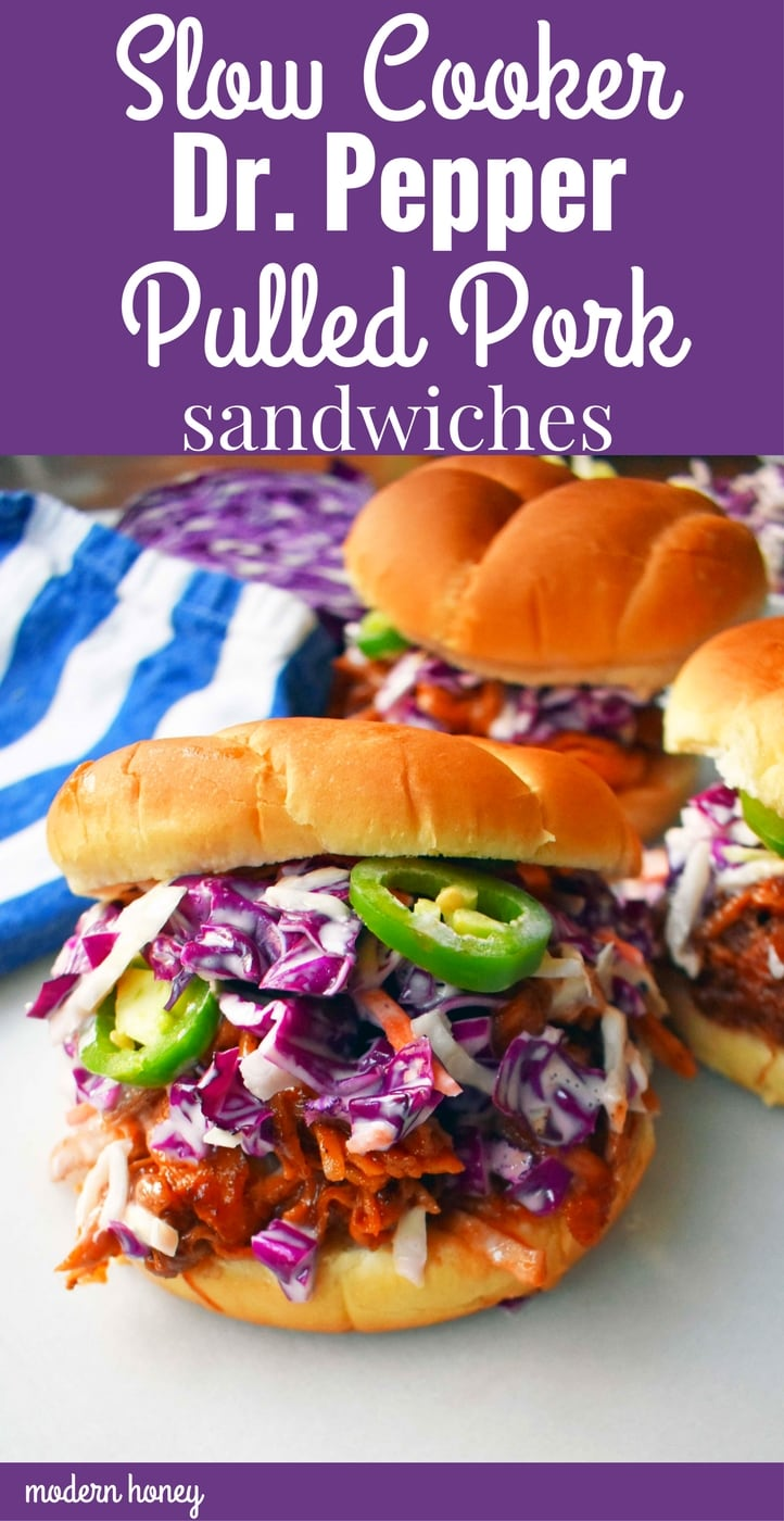 Slow Cooker Dr. Pepper Pulled Pork Sandwich. Slow cooked pork simmered with Dr. Pepper, spices, and BBQ sauce. Topped with homemade coleslaw and fresh jalapenos, all on a soft bun. The perfect BBQ Pulled Pork Sandwich. www.modernhoney.com