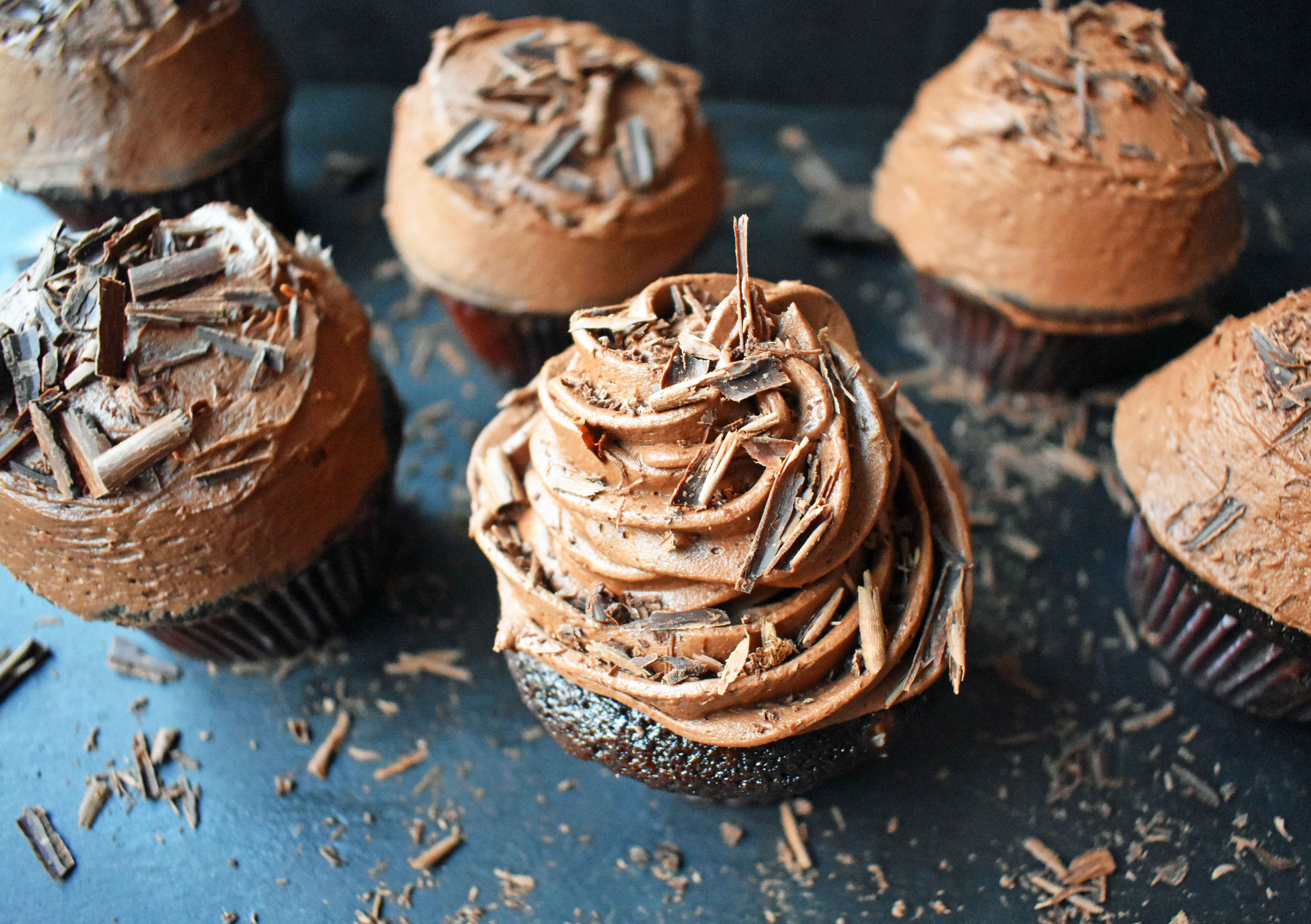Chocolate Bombshell Birthday Cupcakes. Rich, tender, and fluffy chocolate cake topped with homemade perfect chocolate buttercream frosting. A match made in heaven! These are the ultimate chocolate cupcake. www.modernhoney.com