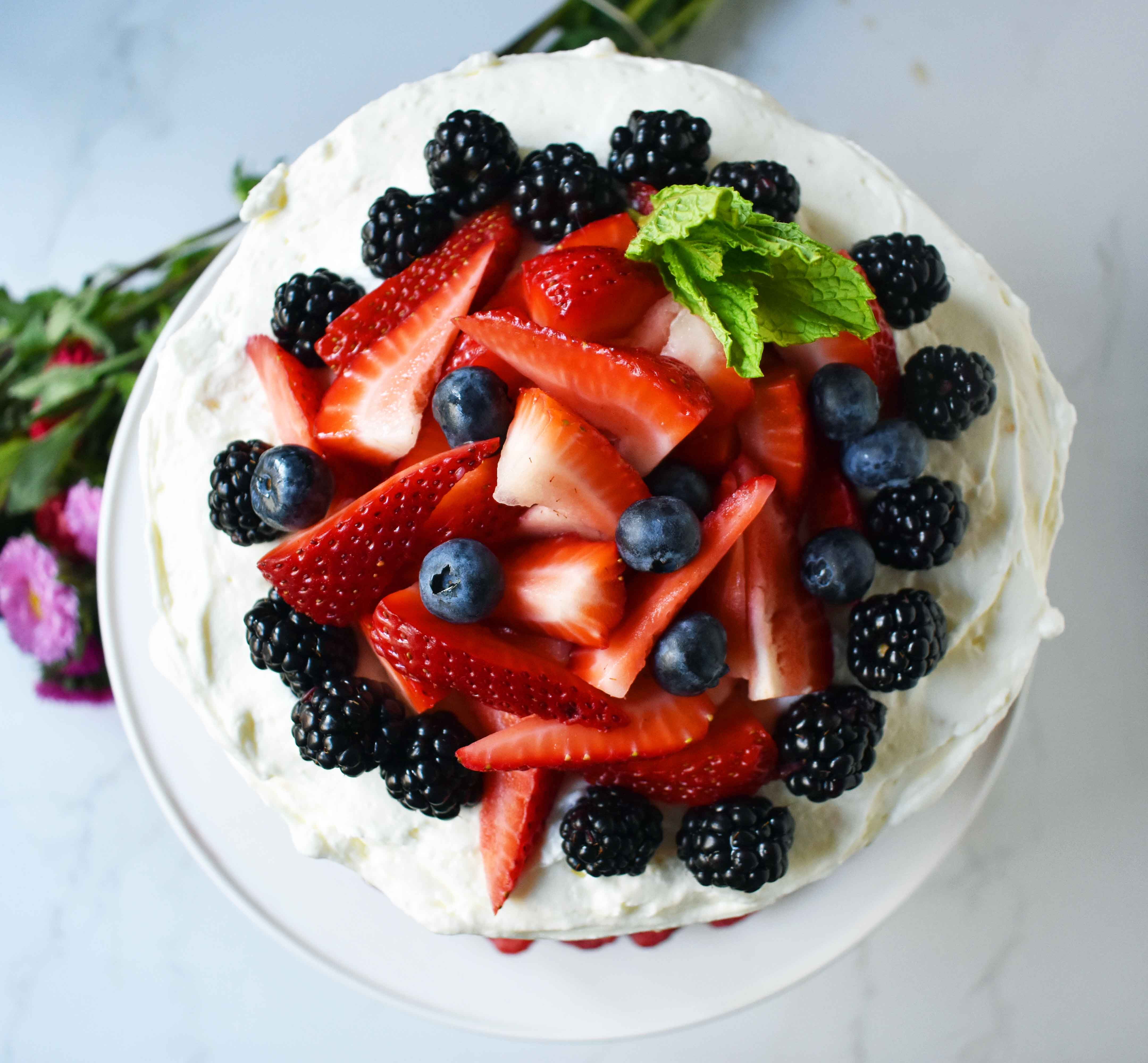 Berry Chantilly Cream Cake. Layers of perfect yellow cake, chantilly cream, jam, and fresh strawberries, raspberries, blackberries, and blueberries. The perfect Spring and Summer dessert that everyone will love. www.modernhoney.com