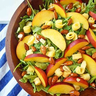 Peach Gouda Honey Almond Salad. Arugula, Creamy Gouda Cheese, Sweet Peaches or Nectarines, and Honey Glazed Almonds tossed with a Sweet Honey Dressing. www.modernhoney.com