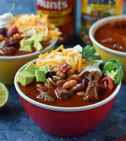 MJ's Award-Winning Chili is made with tender beef chuck roast simmered to perfection, onions, peppers, chili beans, fire-roasted tomatoes, and mexican spices. A perfect prize-winning chili recipe. www.modernhoney.com