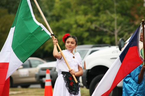 Young Girl Carrying Mexican Flag