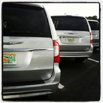 Three Chrysler Town & Country Vans in a Row
