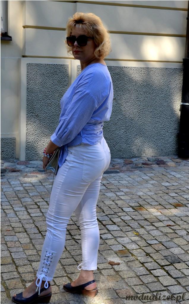 Eleganckie dopasowane białe spodnie