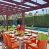 Mid-century dining by pool at Moderne Vacations rental