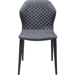 Stuhl: Gut gesteppt Spannungsvoll gestalteter Polsterstuhl in dunklem Grau. Raffininierte Optik durcvh reizvolle Rautensteppung und geschwungenen Formen. Sitzhöhe: 47 cm. 50.0000 Martindale. Auch mit Armlehne und als Barstuhl erhältlich.