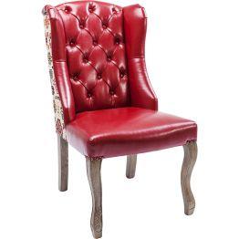 Stuhl: Polsterstuhl im spannungsvollen Stil- und Materialmix. Folklore Muster zieren die Rückseite. Bezug in warmen Rot. Rückenlehne mit aufwendiger Knopfheftung. Weiche Polsterung für komfortables Sitzerlebnis.