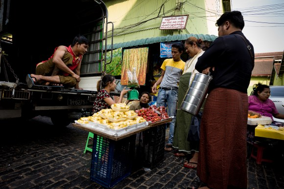 Fruit seller discussing their daily sales