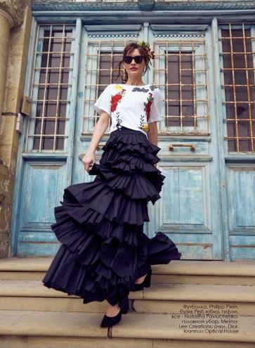 Top, Philipp Plein, First boutique; skirt, shoes, all - Natasha Pavluchenko Neo Couture; headpiece, Melina-Lee Creations; glasses, Dior, Ioannou Optical House