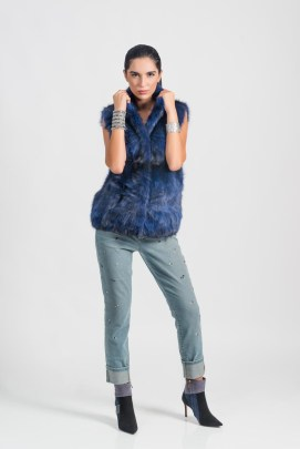 Blue sable vest (dyed color), Malimo; jeans, bracelet with black stones, all - Marc Cain; booties, Baldinini; bracelet (all metal) stylist's own.