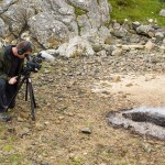Food Over 50 director Jonathan White photographing heather fired salmon on the beach in Scotland