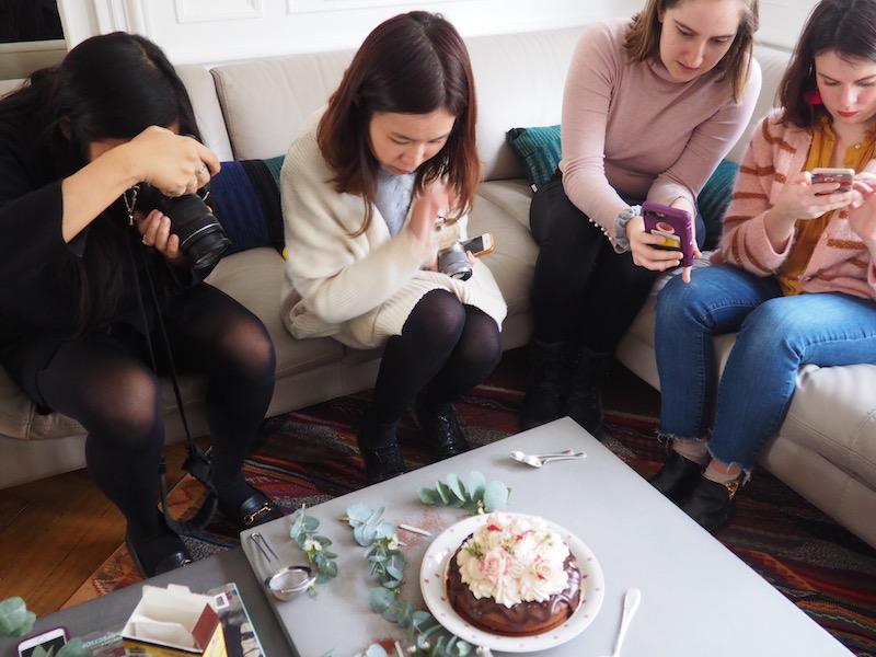 Taking pictures of a chocolate chestnut cake in a food photography workshop in Paris