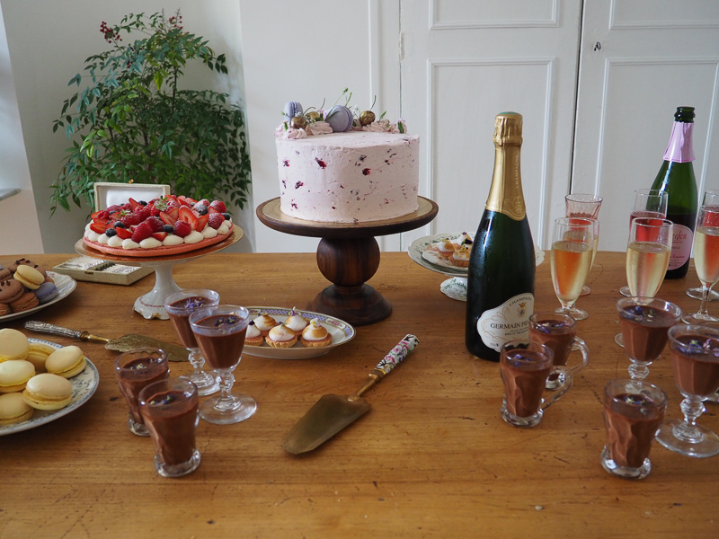 A tea party with lavender lemon cherry cake and champagne
