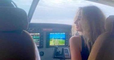 صورة وزير الطيران هنا الزاهد داخل قمرة قيادة طائرة فى دولة تنزانيا وليس بمصر