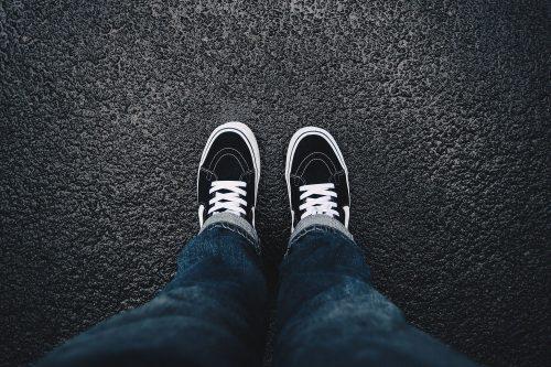 Big boy looking down at his black shoes.