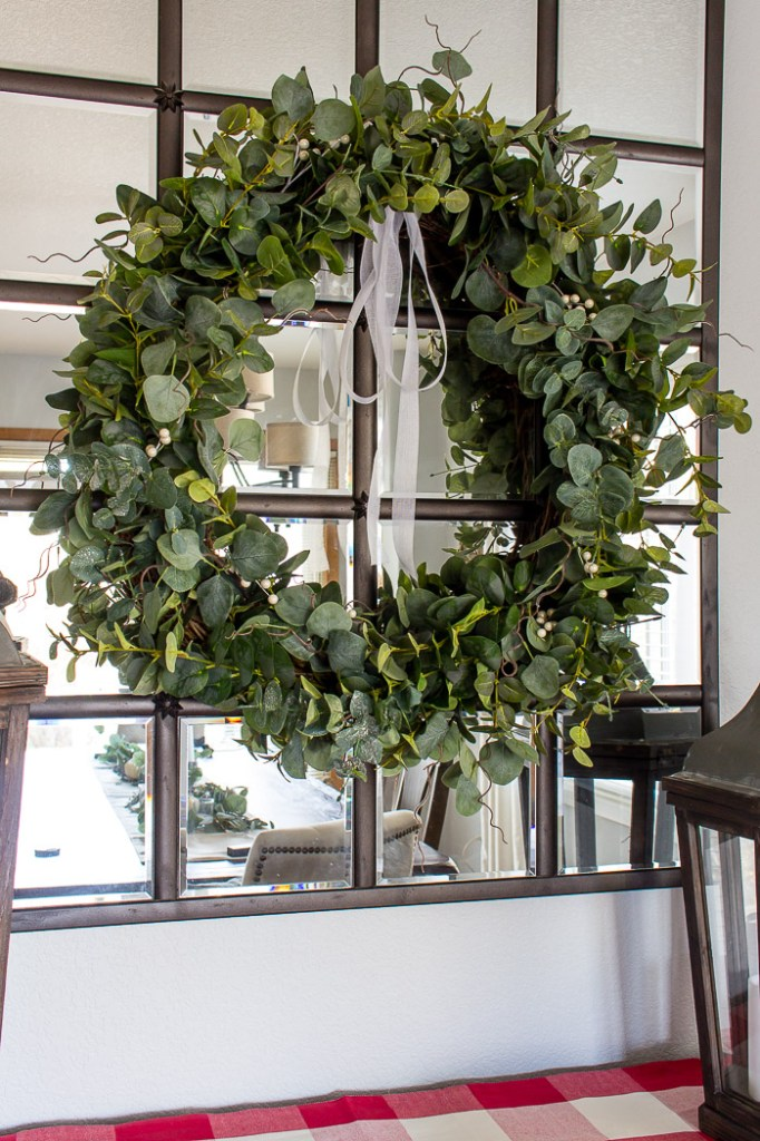 This DIY eucalyptus wreath is on of my 12+ favorite Christmas Wreath tutorials. Learn how to make wreaths to decorate your home, everywhere from your front door to your kitchen! The wreaths use everything from fresh evergreens to puzzle pieces (a genius way to save money when you make your wreath. You gotta see it!) and everything in between. Check it out to get some fabulous ideas.