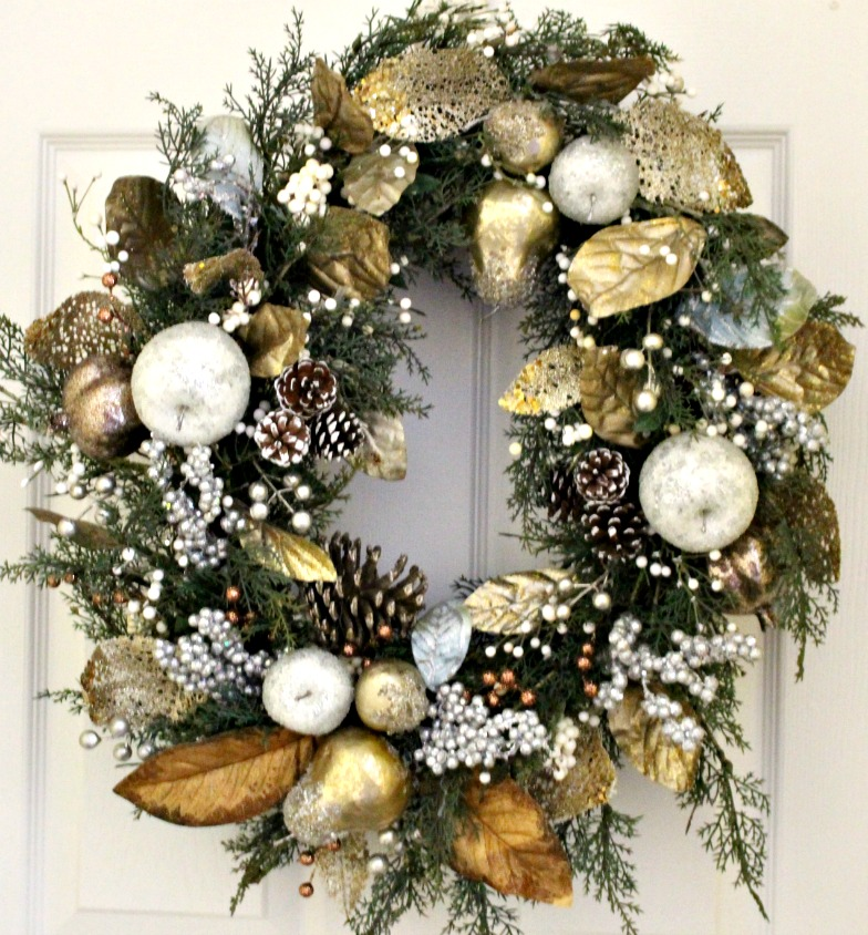 This DIY Sugared Fruit Wreath is on of my 12+ favorite Christmas Wreath tutorials. Learn how to make wreaths to decorate your home, everywhere from your front door to your kitchen! The wreaths use everything from fresh evergreens to puzzle pieces (a genius way to save money when you make your wreath. You gotta see it!) and everything in between. Check it out to get some fabulous ideas.