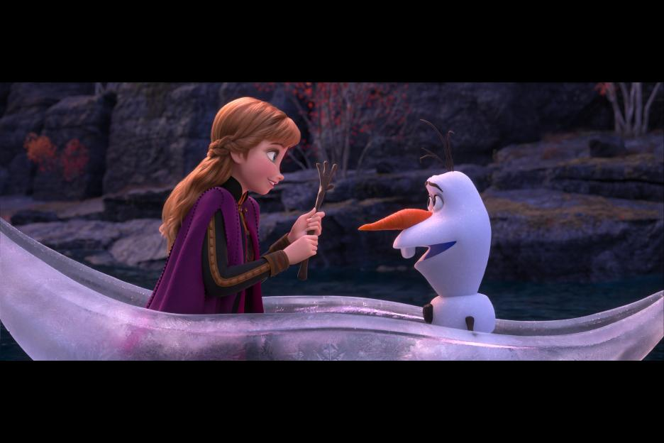 Frozen 2 movie image, Anna & Olaf in ice boat. Image from Disney Studios.