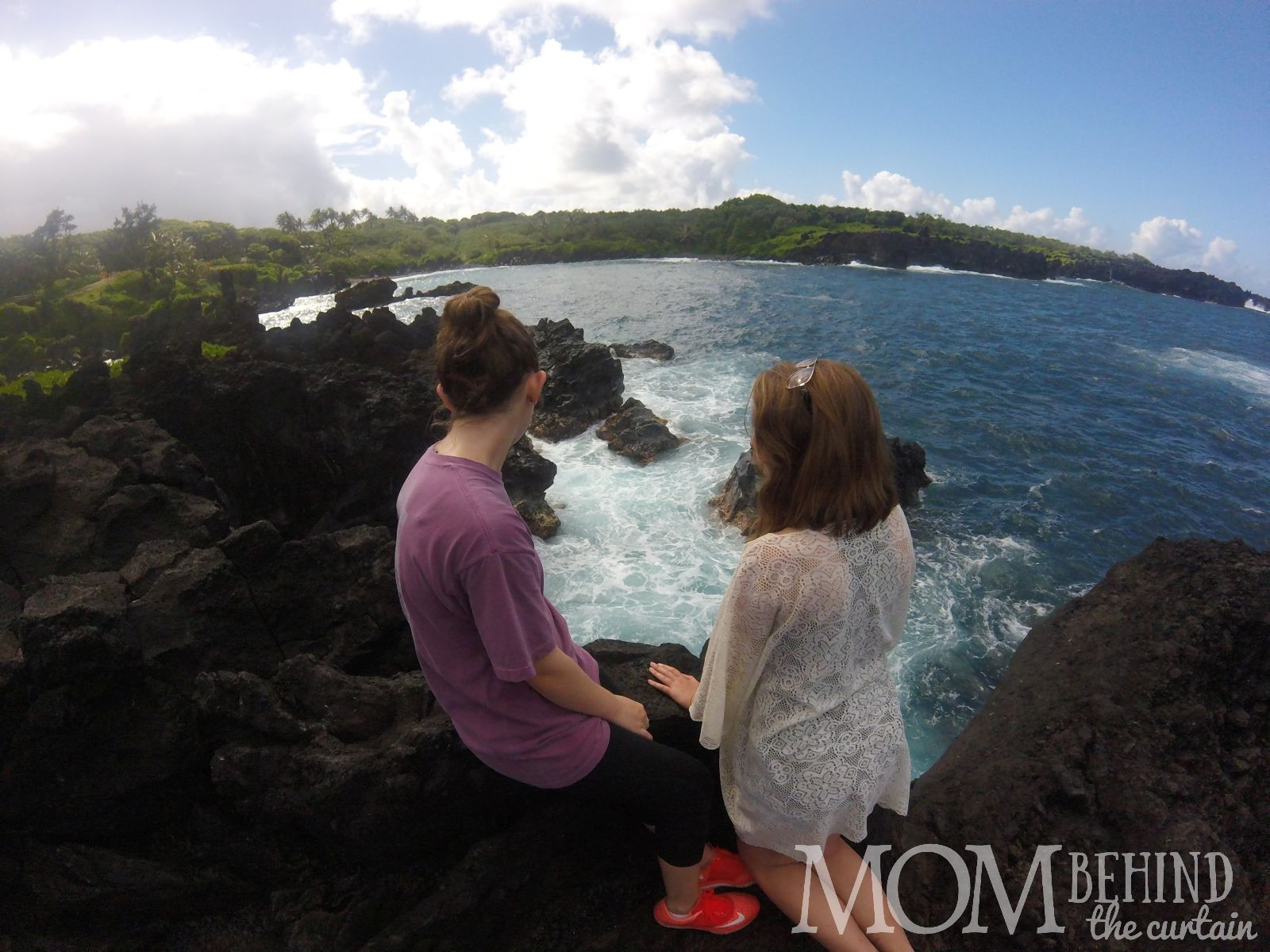 GOPRO photo of black sand beach taken in Hawaii with teens.