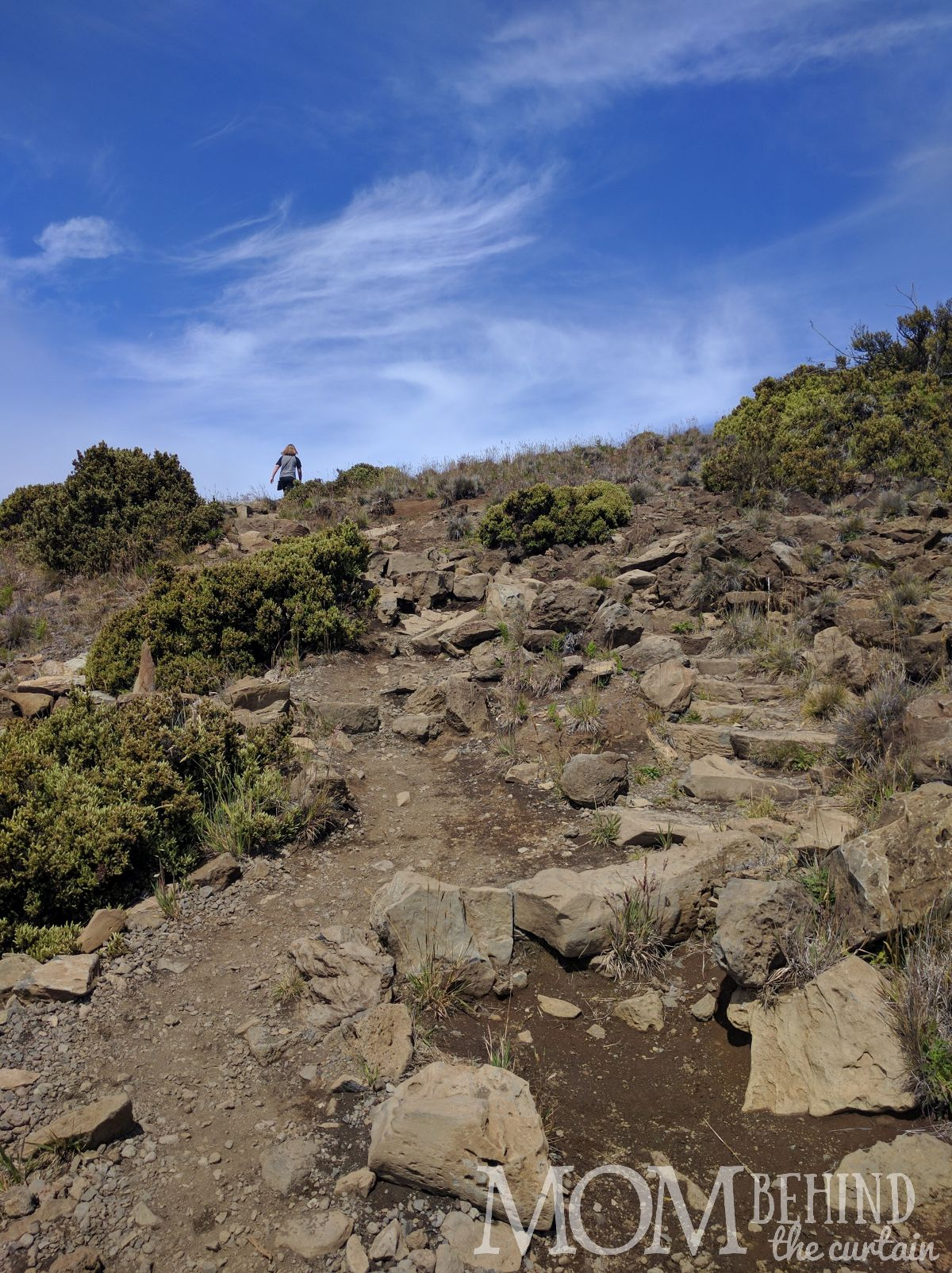 hiking rocky trail to Leleiwi Lookout, Maui
