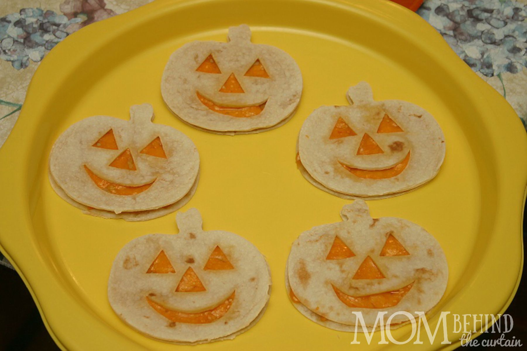 jack o lantern quesadillas with stems - Halloween Party Food - ideas for kids party that are easy. And sometimes healthy! Okay, is anything really healthy besides kale? These are at least healthier than the candy that's - let's face it - going to be consumed in massive quantities!