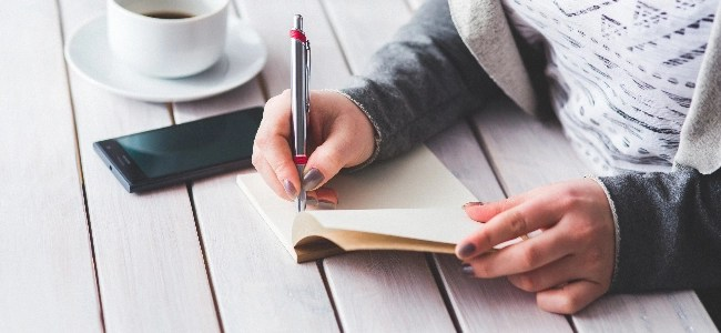 woman writing notes. how to make money writing?