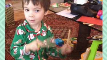What NOT to Get a Kid for Christmas MomCave Photos of young boy in Christmas pajamas playing a toy drum set