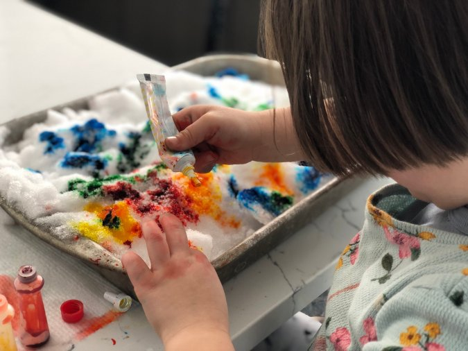 Things to do on a snow day indoors-- snow painting with food coloring --great snow day activity for kids from MomCave