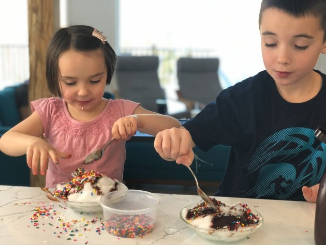 A great thing to do indoors on a snow day is make snow sundaes!