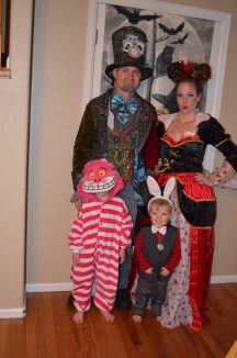 Halloween costumes for famlies. Photo of family dressed up for Haloween, mom, dad, and two kids