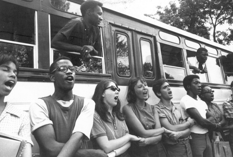 "Freedom summer volunteers singing ""We Shall Overcome,"" the anthem of the Civil Rights Movement on June 19, 1964."