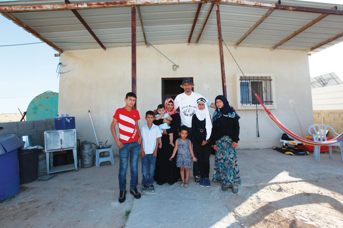 Abu-Quian Family in front of their home