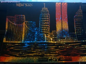 The view of Manhattan, NY done on a scratch paper with a match.