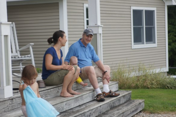 Generations enjoying time together on the porch.