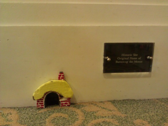 A snazzy mouse house in the children's section.