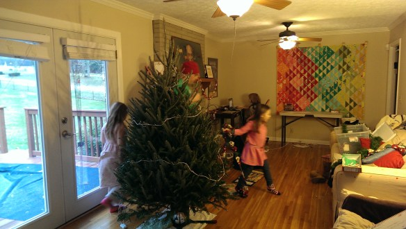 The tree goes up!