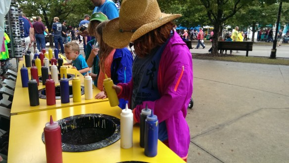 The spin art tradition continues, but now with  cowgirl hats.