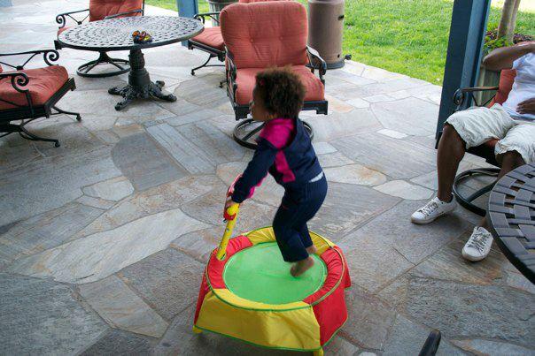 Girl jumping in kids trampoline
