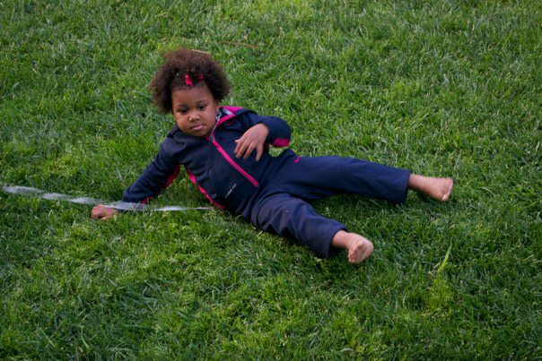 Girl playing in the grass