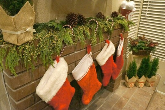 Christmas stockings hanging over the fireplace