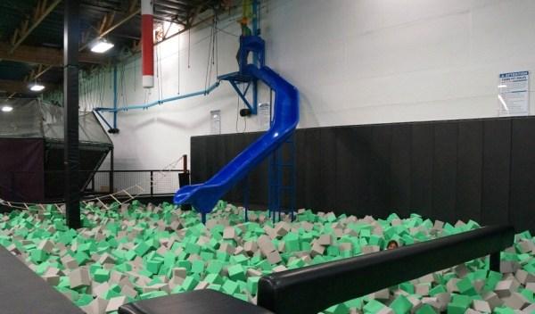 Suspension bridge and slide at Jump Around Now Trampoline Park