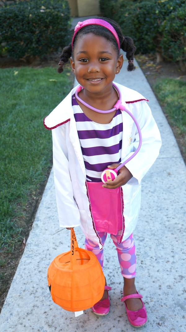 Girl dressed in Disney Junior's Doc McStuffins Halloween Costume