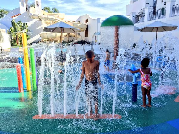 Kids playing at the Omni La Costa pool splash pad