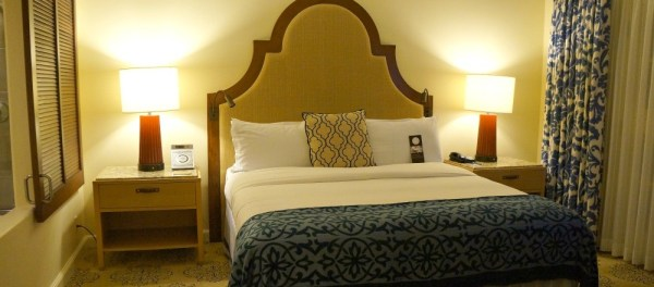 Luxurious king sized bed in rooms at the Omni La Costa Resort