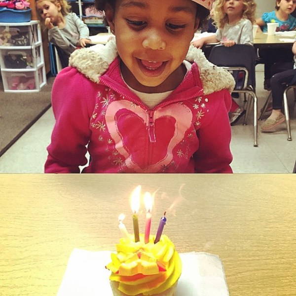 Birthday girl blowing out candles