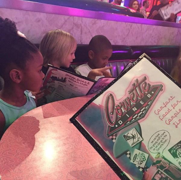 Corvette Diner Family Restaurant, kids reading the menu