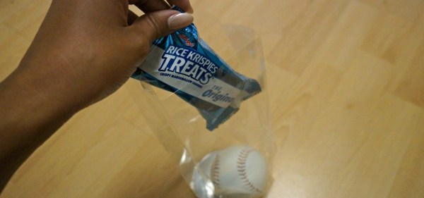 DIY Baseball team favors, place the Rice Krispies Treats® into the bag