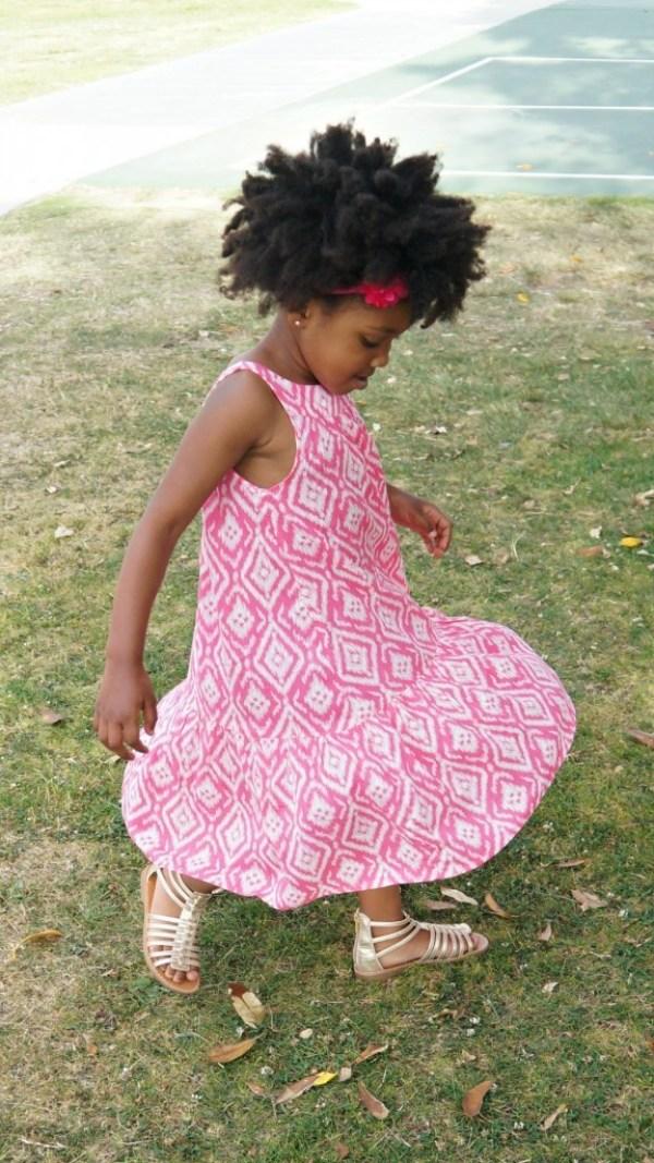 Girl twirling in her OshKosh B'Gosh summer dress